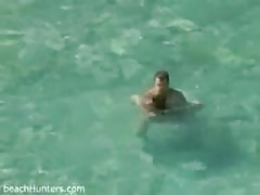 Couple having sex in the sea
