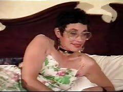 Kinky short-haired mature in glasses is performing a nice hot blowjob