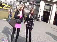 Two slutty hotties give a blowjob right in the street for money