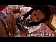 Kinky black schoolgirl is kneeling down and starting to suck a white cock